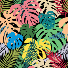 Fototapeta Do pokoju Seamless vector pattern of colorful leaves monstera and palm. Exotic tropical repeat ornament