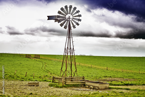 Windmill and cloudy sky