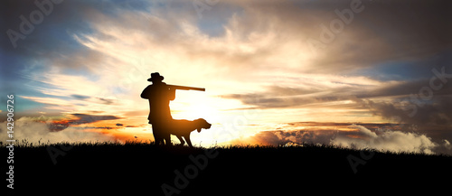 Aluminium Prints Hunting hunter with dog at sunset