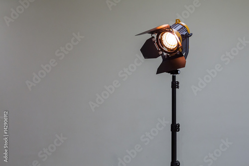 Foto op Canvas Licht, schaduw Spotlight with halogen bulb and Fresnel lens. Lighting equipment for Studio photography or videography.