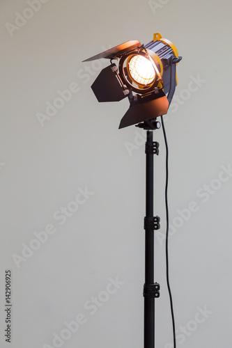 Obraz Spotlight with halogen bulb and Fresnel lens. Lighting equipment for Studio photography or videography. - fototapety do salonu