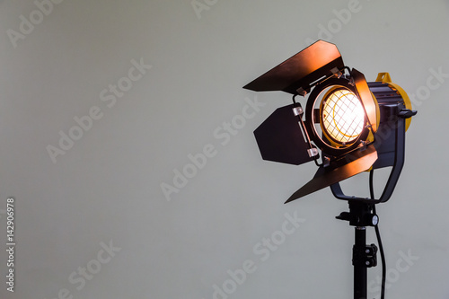 Poster Licht, schaduw Spotlight with halogen bulb and Fresnel lens. Lighting equipment for Studio photography or videography.