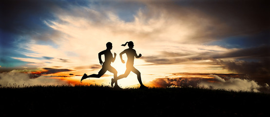 Fototapeta Young couple run together on a sunset