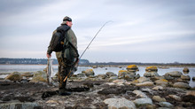 Lonely Angler With Big Sea Trout