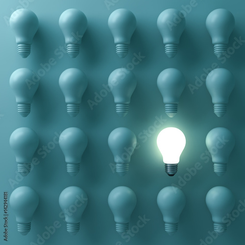Fotografie, Obraz  One glowing light bulb standing out from the unlit incandescent bulbs on green background with reflection , individuality and different creative business bright idea concepts
