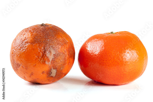 Fotografie, Obraz  fresh and damaged tangerine isolated on white background