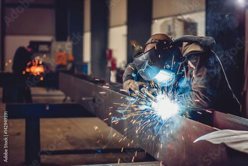 Photo  Industrial Welder With Torch
