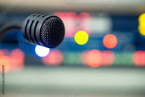 Fotografia, Obraz  Black operator microphone on the control panel on the television