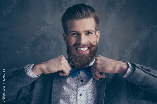 portrait of stylish hipster young man with mustache, beard and beautiful hairsty Wallpaper Mural