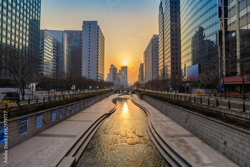 Cheonggyecheon Stream and Seoul city skyline when sunrise, Seoul, South Korea