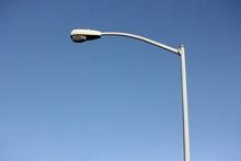 Street Light Pole On A Blue Sky