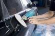 Auto body repair series : Closeup of polishing black car paint