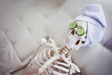 Skeleton In Spa Salon With Tow...