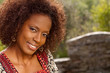 Beautiful mature African American woman smiling outside.