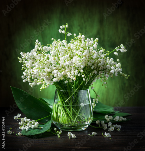 Wall Murals Lily of the valley Lily of the valley bouquet on the wooden table.
