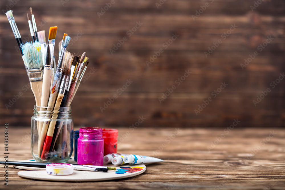 Fototapety, obrazy: Artist's workshop. Top view of paintbrushes palette and acrylic paints with white canvas. Set of brushes and oil paints. Art picture with copy space and for add text.Items for children's creativity