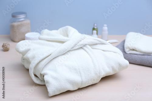 Fotografie, Obraz  Folded spa bathrobe on table