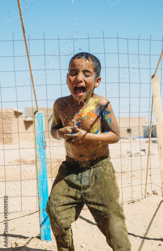 A boy washing from colors