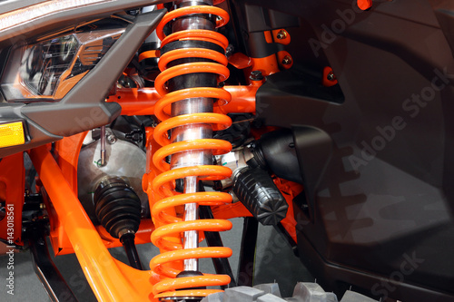 Photo all terrain vehicle shock absorber close up
