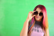 canvas print picture - Trendy hairstyle concept. Young woman with colorful dyed hair on color background