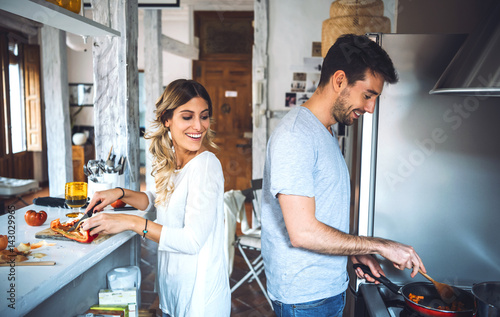 Fototapeta Happy couple cooking together obraz
