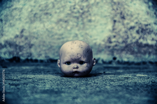 Canvas Print Head of spooky doll in haunted house