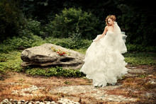 Gorgeous Bride In A Lush White Dress Is Dancing In Nature.