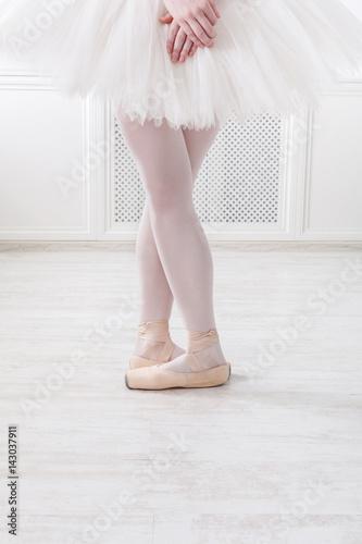 Ballerina legs closeup in fifth position
