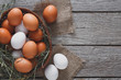 Fresh chicken brown eggs on sack, organic farming background