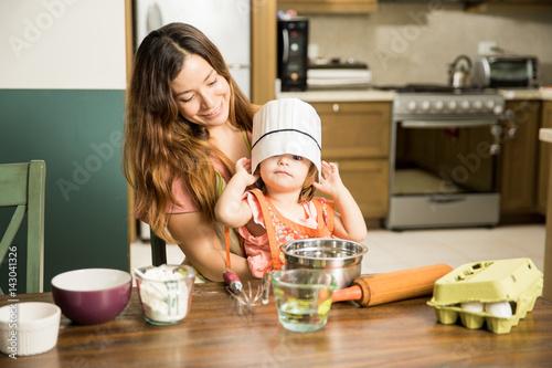 Fotografie, Obraz  Cute little girl wearing a chef's hat