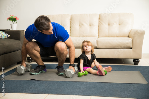 Fotografie, Obraz  Girl exercising with her father