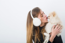 Pretty Girl Kissing Cute Pomer...