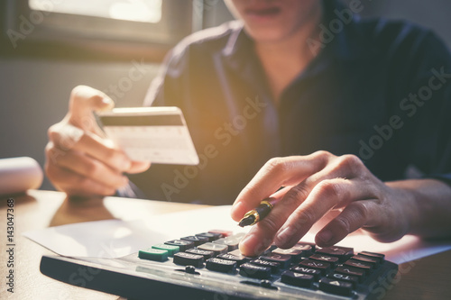 Saving Money Concept Man Hand Using Calculator And Holding Credit Card Ping Online Row Coin