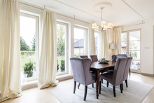 Spacious Dining Room In White Tones