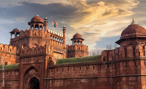 Recess Fitting Fortification Red Fort Delhi at sunset with moody sky - A UNESCO World heritage site.