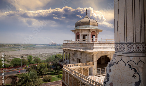 Fortification Agra fort view of Taj Mahal from Musamman Burj dome. Agra fort is a UNESCO world heritage site and a classic example of Mughal architecture in India.