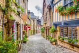 Fototapeta Alley - Beautiful alley scene in an old town in Europe