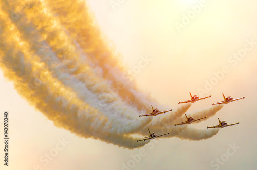 Aircraft fighter jets smoke the background of sky and sun Wallpaper Mural