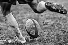 Legs Of Rugby player Kicking Ball