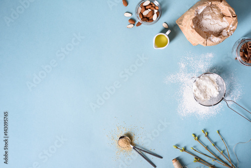 Fotografía  Baking ingredients for pastry on the blue background