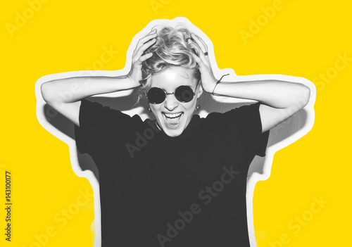 Stickers pour porte Magasin de musique Stylish fashion blonde with short hair colorful collage. Crazy girl in a black t-shirt and rock sunglasses scream holding her head. Rocky emotional woman. white toned. yellow background, not isolated