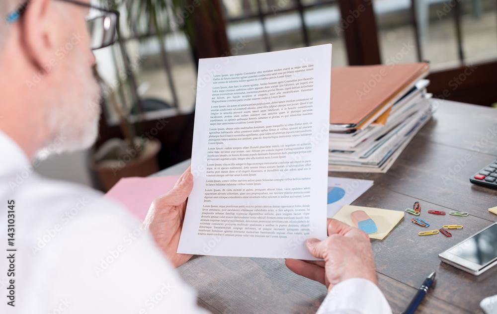Fototapeta Businessman checking a document
