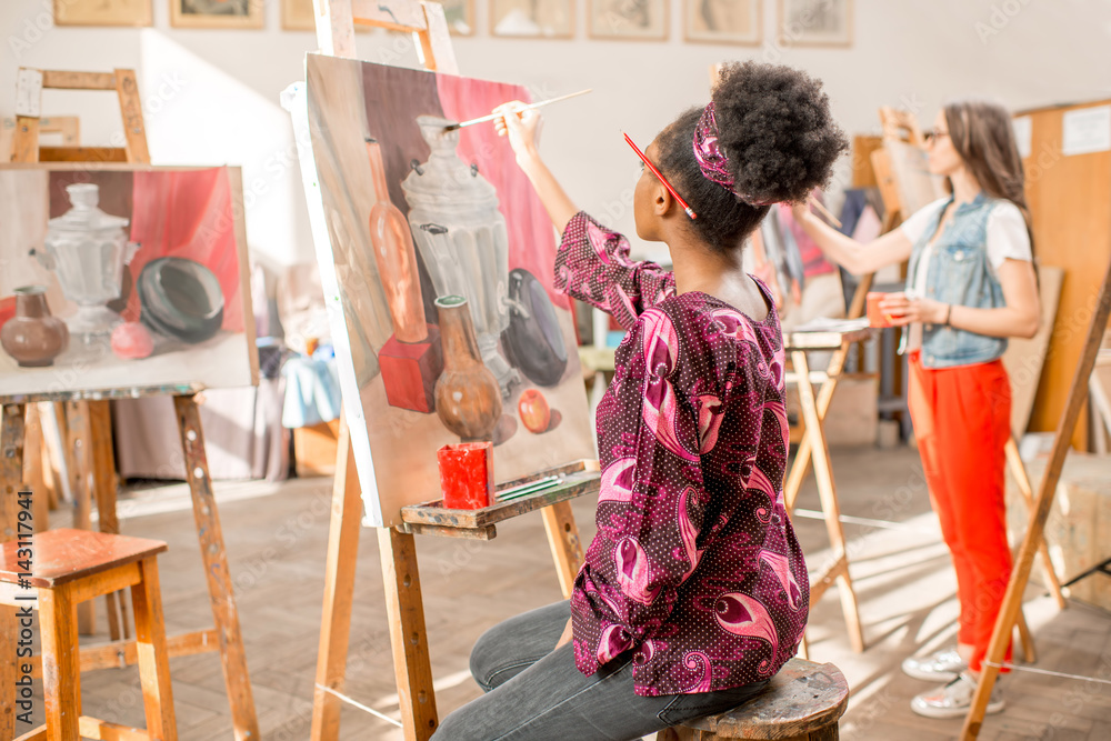 Fototapety, obrazy: Young african student painting still life painting at the studio