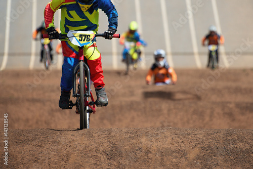 Photo BMX riders competing in the child class