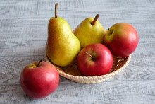 Apples And Pears On A Wooden T...