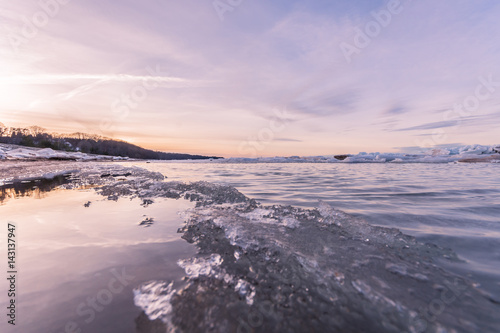 Fotobehang Purper Winter landscape. Sea covered blocks of ice.