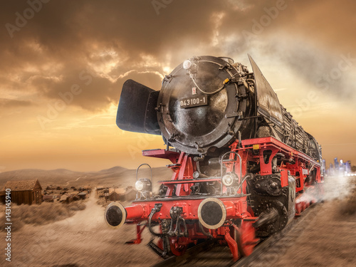 Fotomural Steam locomotive drives through the desert