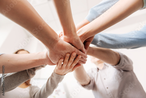 Fototapety, obrazy: Close up of coworkers hands being united