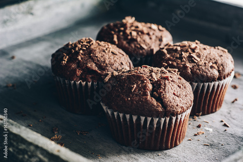 Fotografie, Obraz  Chocolate muffins on gray wooden tray
