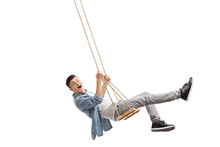 Joyful Teenager Swinging On A Swing